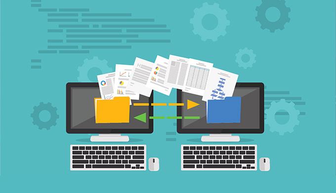 Dessin de deux ordinateurs se partageant des fichiers